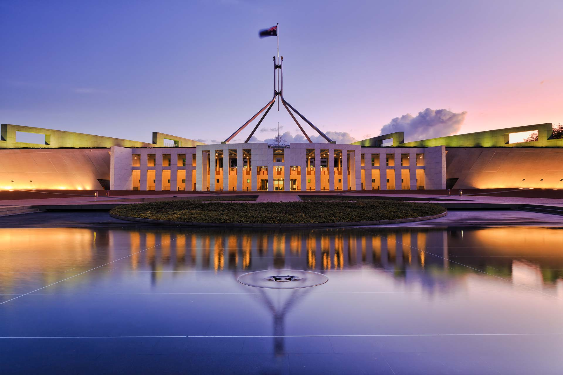 The Australian Federal Parliament House, reflected In a pool
